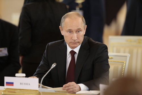 Russian President Vladimir Putin attends the Gas Exporting Countries Forum (GECF) in the Kremlin in Moscow, Monday, July 1, 2013. (AP Photo/Ivan Sekretarev, Pool)