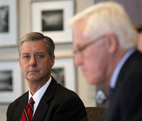 Al Hartmann  |  The Salt Lake Tribune University of Utah Athletic Director Chris HIll, left, listens to Alan Sullivan, investigator for Snell & Wilmer, present results of investigation of former University of Utah swim coach Greg Winslow in a press conference in Salt Lake City Tuesday July 2.