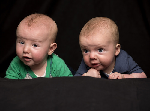 New research shows babies can sense each other's emotions at five months old. Shown here are a pair of cousins, 4-month-old Markham Reid Carter in blue and 5-month-old Lucas Dowell Richardson in green.  Jaren Wilkey | Brigham Young University