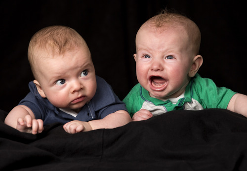 Jaren Wilkey | Brigham Young University New research shows babies can sense each other's emotions at five months old. Shown here are a pair of cousins, 4-month-old Markham Reid Carter in blue and 5-month-old Lucas Dowell Richardson in green.