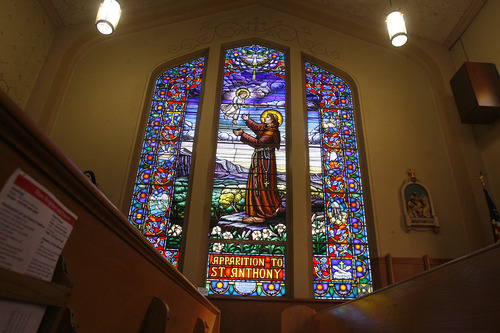 Scott Sommerdorf   |  The Salt Lake Tribune A wall of stained glass inside Our Lady of Lourdes Catholic Church. The church is celebrating its 100th anniversary. Sunday, June 23, 2013.