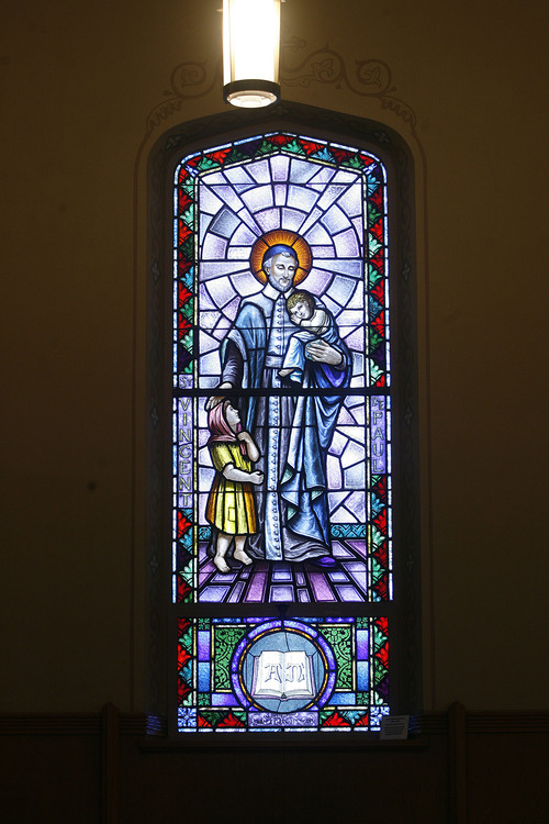 Scott Sommerdorf   |  The Salt Lake Tribune Stained glass of St. Vincent de Paul, a 17th century Frenchman who founded two religious orders. The window is inside Our Lady of Lourdes Catholic Church in Salt Lake City.