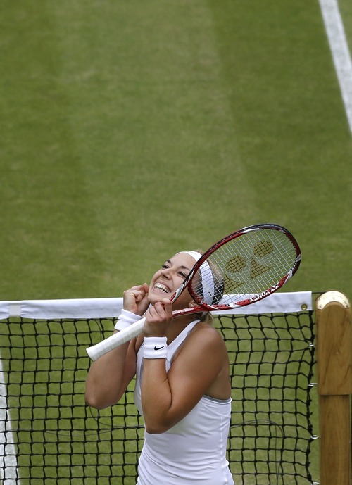 Sabine Lisicki of Germany reacts as she wins a Women's singles quarterfinal match against Kaia Kanepi of Estonia at the All England Lawn Tennis Championships in Wimbledon, London, Tuesday, July 2, 2013. (AP Photo/Anja Niedringhaus)