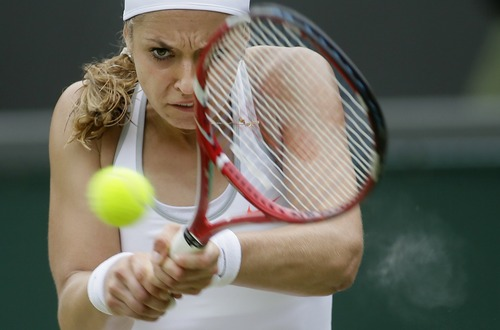 Sabine Lisicki of Germany plays a return to Kaia Kanepi of Estonia in a Women's singles quarterfinal match at the All England Lawn Tennis Championships in Wimbledon, London, Tuesday, July 2, 2013. (AP Photo/Alastair Grant)