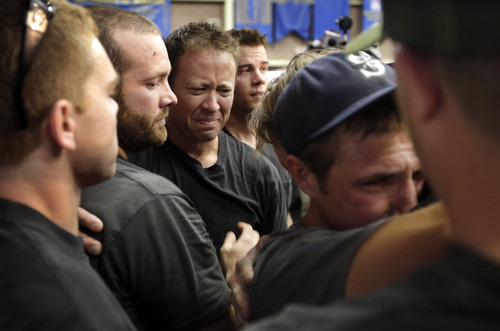 Firefighters gather during a memorial service Monday, July 1, 2013, in Prescott, Ariz., honoring their 19 fellow firefighters killed battling a wildfire near Yarnell, Ariz., Sunday. All but one of the Prescott-based Granite Mountain Hotshots' 20 members died Sunday when a wind-whipped wildfire overran them on a mountainside north of Phoenix. (AP Photo/Chris Carlson)