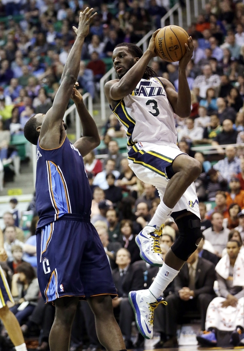 Utah Jazz's DeMarre Carroll (3) passes the ball as Charlotte Bobcats' Michael Kidd-Gilchrist, left, defends in the second half during an NBA basketball game Friday, March 1, 2013, in Salt Lake City. The Jazz defeated the Bobcats 98-68. (AP Photo/Rick Bowmer)