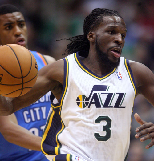 Steve Griffin | The Salt Lake Tribune   Utah's Demarre Carroll drives into the lane during a preseason game against the Thunder at EnergySolutions Arena in Salt Lake City on Friday, Oct. 12, 2012.