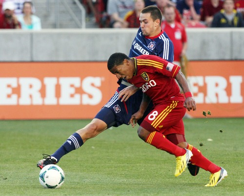 Kim Raff  |  The Salt Lake Tribune (right) Real Salt Lake forward Joao Plata (8) tries to dribble past (left) Chicago Fire defender Austin Berry (22) during the first half of the match at Rio Tinto Stadium in Sandy on May 25, 2013.