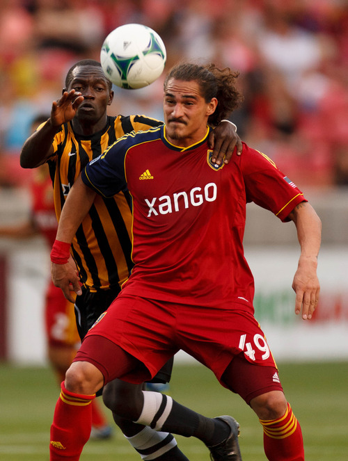 Trent Nelson  |  The Salt Lake Tribune Real Salt Lake's Devon Sandoval and Charleston's Micheal Azira fight for the ball as Real Salt Lake hosts Charleston Battery in the US Open Cup Wednesday June 12, 2013 at Rio Tinto Stadium in Sandy, Utah.