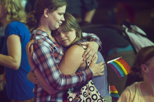 Chris Detrick  |  The Salt Lake Tribune Piper Kenny, left, and her fiancé Alix Young-Jui, who have been together for over three years, dance during a party to show unity, love and celebrate all Utah families at Club Sound Wednesday June 26, 2013.  In historic decisions, the Supreme Court handed gay-rights supporters major victories Wednesday, extending federal rights to same-sex couples and reversing a ban on gay marriage in the nation's largest state.