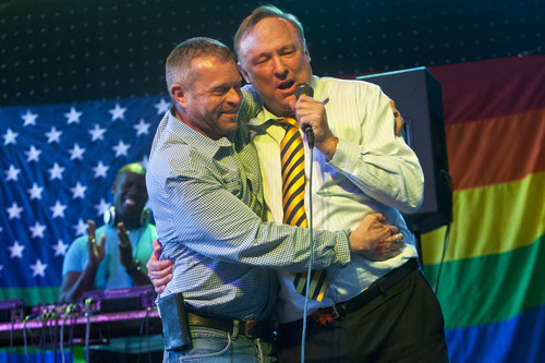 Chris Detrick  |  The Salt Lake Tribune Sen. Jim Dabakis, D-Salt Lake City, proposes to Stephen Justesen, his boyfriend of over twenty-five years, during a party to show unity, love and celebrate all Utah families at Club Sound Wednesday June 26, 2013.  In historic decisions, the Supreme Court handed gay-rights supporters major victories Wednesday, extending federal rights to same-sex couples and reversing a ban on gay marriage in the nation's largest state.