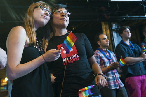 Chris Detrick  |  The Salt Lake Tribune Nicole Bedera and Jem Locquiao, who have been together for 3.5 years, embrace during a party to show unity, love and celebrate all Utah families at Club Sound Wednesday June 26, 2013.  In historic decisions, the Supreme Court handed gay-rights supporters major victories Wednesday, extending federal rights to same-sex couples and reversing a ban on gay marriage in the nation's largest state.