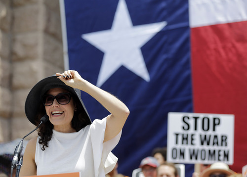 Actress Lisa Edelstein speaks during a rally supporting abortion rights outside the Texas Capitol, Monday, July 1, 2013, in Austin, Texas. The Texas Senate has convened for a new 30-day special session to take up contentious abortion restrictions bill and other issues. (AP Photo/Eric Gay)