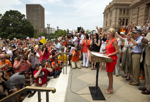 State Sen. Wendy Davis, D-Fort Worth, speaks at a pro-abortion rights rally at the state Capitol in Austin, Texas, on Monday July 1, 2013.  The Texas Senate has convened for a new 30-day special session to take up contentious abortion restrictions bill and other issues. (AP Photo/Statesman.com, Jay Janner)