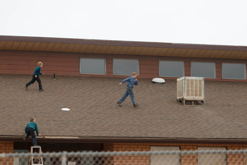 Trent Nelson     The Salt Lake Tribune Children playing on roof of the Colorado City Unified School building Friday November 30, 2012 in Colorado City.