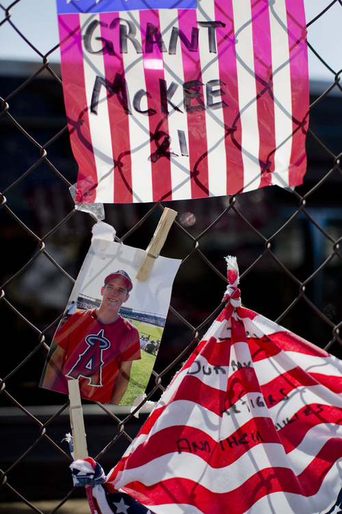 A photo of Hotshot firefighter Grant McKee hangs on a fence outside the Granite Mountain Interagency Hotshot Crew fire station, Tuesday, July 2, 2013 in Prescott, Ariz. McKee was one of 19 members of the Granite Mountain Hotshots, based in Prescott, who were killed Sunday when a windblown wildfire overcame them north of Phoenix. It was the deadliest single day for U.S. firefighters since 9/11. Fourteen of the victims were in their 20s.  (AP Photo/Julie Jacobson)