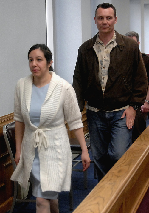 File  |  The Associated Press Leilani and Dale Neumann leave a Marathon County Circuit Courtroom in Wausau, Wis., in 2008. On Wednesday, the Wisconsin Supreme Court ruled that the mother and father who prayed instead of seeking medical help as their 11-year-old daughter, Madeline Kara Neumann, died in front of them were properly convicted of homicide. Their daughter died of undiagnosed diabetes on Easter Sunday in March 2008 at her parents, Weston, Wis., home.