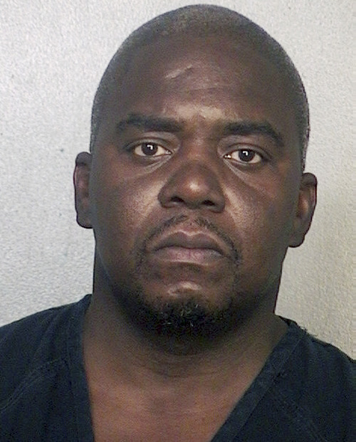 This booking photo released via the website of the Broward County Sheriff's Office shows Ernest Wallace, arrested June 28, 2013 when he surrendered at a police station in Miramar, Fla.  Authorities had been seeking Wallace on a charge of acting as an accessory after the murder of Ovid Lloyd on June 17 in North Attleborough, Mass. Former New England Patriots tight end Aaron Hernandez has been charged with Lloyd's murder. (AP Photo/Broward County Sheriff's Office)