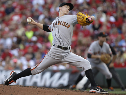 San Francisco Giants starting pitcher Tim Lincecum throws against the Cincinnati Reds in the first inning of a baseball game, Tuesday, July 2, 2013, in Cincinnati. (AP Photo/Al Behrman)
