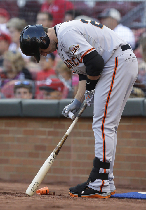 San Francisco Giants' Buster Posey waits to bat against the Cincinnati Reds in the first inning of a baseball game, Tuesday, July 2, 2013, in Cincinnati. (AP Photo/Al Behrman)