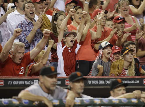 Cincinnati Reds fans react with two outs in the ninth inning of a baseball game against the San Francisco Giants, Tuesday, July 2, 2013, in Cincinnati. Cincinnati won 3-0 behind a no-hitter by Homer Bailey. (AP Photo/Al Behrman)