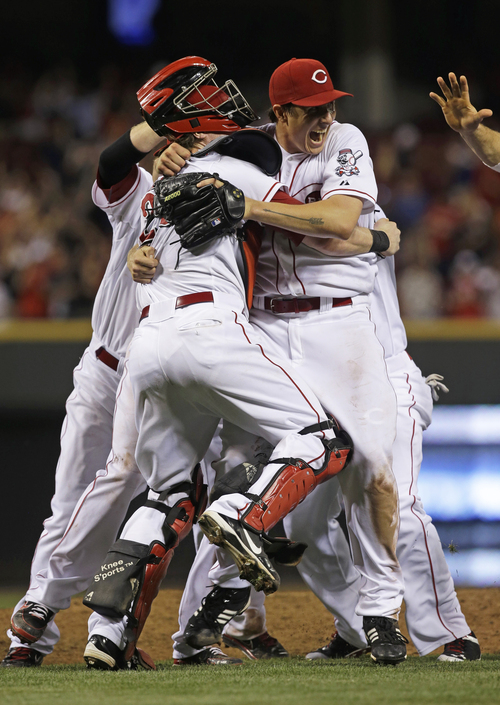 Cincinnati Reds starting pitcher Homer Bailey, right, celebrates after throwing a no-hitter against the San Francisco Giants in a baseball game, Tuesday, July 2, 2013, in Cincinnati. (AP Photo/Al Behrman)
