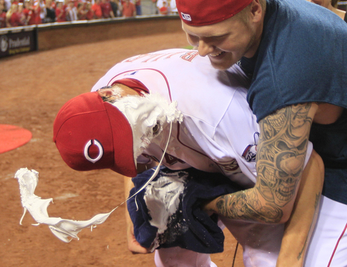 Cincinnati Reds starting pitcher Homer Bailey, left, gets his face covered by shaving cream by Mat Latos after Bailey threw a no-hitter against the San Francisco Giants in a baseball game, Tuesday, July 2, 2013, in Cincinnati. (AP Photo/Al Behrman)