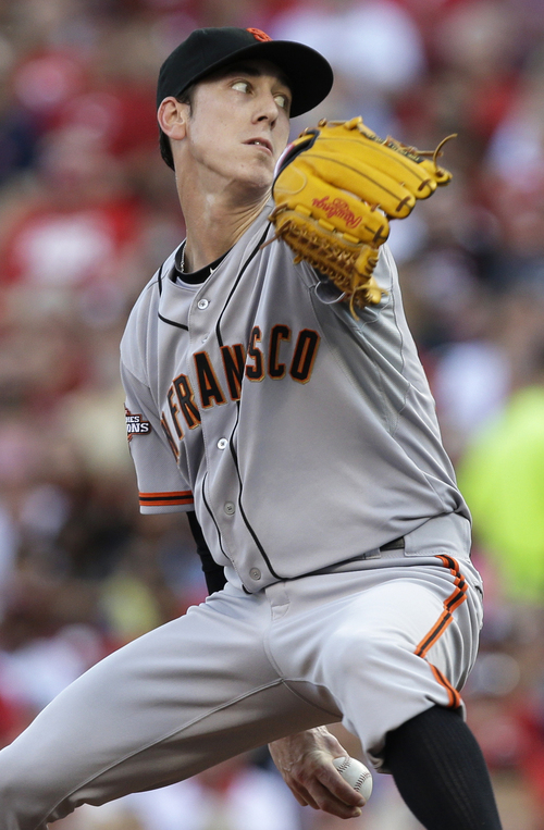 San Francisco Giants starting pitcher Tim Lincecum throws to a Cincinnati Reds batter in the first inning of a baseball game, Tuesday, July 2, 2013, in Cincinnati. (AP Photo/Al Behrman)