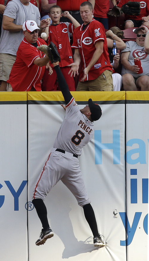 San Francisco Giants right fielder Hunter Pence (8) cant' catch a ground rule double hit by Cincinnati Reds' Shin-Soo Choo in the first inning of a baseball game, Tuesday, July 2, 2013, in Cincinnati. (AP Photo/Al Behrman)