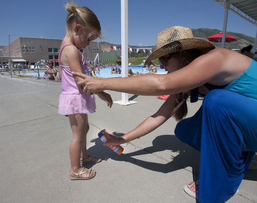 Steve Griffin   The Salt Lake Tribune   Haley Wall sprays sunscreen on her daughter, Elizabeth, 2, during an outing at the Salt Lake CIty Sports Complex in Salt Lake City, Utah Tuesday July 2, 2013.