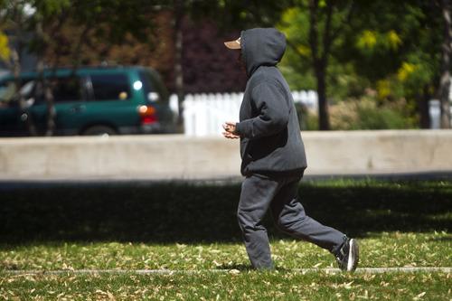 Chris Detrick     The Salt Lake Tribune A runner runs around Liberty Park Tuesday July 2, 2013.