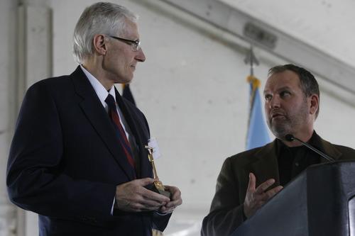 Trent Nelson | The Salt Lake Tribune Utah Lt. Gov. Greg Bell, left, receives a miniature golden shovel from Harvey Davis, director for installations and logistics at the National Security Agency, during the groundbreaking ceremony for the Utah Data Center on Jan. 6, 2011.