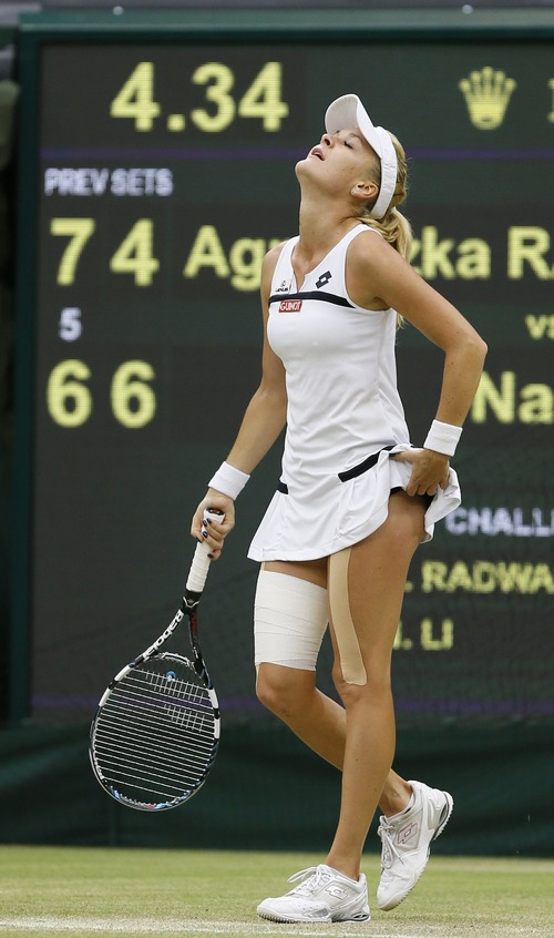 Agnieszka Radwanska of Poland reacts after defeating Li Na of China in their Women's singles quarterfinal match at the All England Lawn Tennis Championships in Wimbledon, London, Tuesday, July 2, 2013. (AP Photo/Kirsty Wigglesworth)