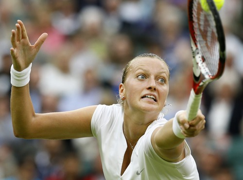 Petra Kvitova of the Czech Republic plays a return to Kirsten Flipkens of Belgium in their Women's singles quarterfinal match at the All England Lawn Tennis Championships in Wimbledon, London, Tuesday, July 2, 2013. (AP Photo/Kirsty Wigglesworth)