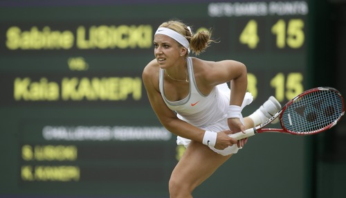 Sabine Lisicki of Germany serves to Kaia Kanepi of Estonia in a Women's singles quarterfinal match at the All England Lawn Tennis Championships in Wimbledon, London, Tuesday, July 2, 2013. (AP Photo/Alastair Grant)
