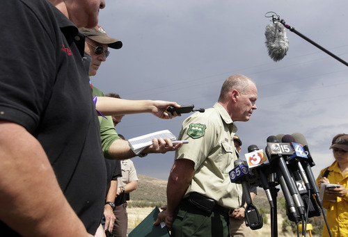 Jim Karels, an investigator from the Florida Forest Service speaks to reporters after he arrived in Yarnell, Ariz., to begin the investigation into the deaths of 19 firefighters, Wednesday, July 3, 2013. An elite crew of firefighters was overtaken by the out-of-control blaze on Sunday, killing 19 members as they tried to protect themselves from the flames under fire-resistant shields. (AP Photo/Chris Carlson)
