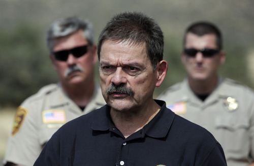 Mike Dudley, an investigator with the U.S. Forest Service, speaks to reporters after he arrived in Yarnell, Ariz., to being an investigation into the deaths of 19 firefighters, Wednesday, July 3, 2013. An elite crew of firefighters was overtaken by the out-of-control blaze on Sunday, killing 19 members of the crew. (AP Photo/Chris Carlson)
