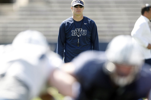 Chris Detrick  |  The Salt Lake Tribune Brigham Young Cougars head coach Bronco Mendenhall watches during the spring scrimmage at LaVell Edwards Stadium on March 30, 2013. He said last week he is happy with BYU's move to independence.