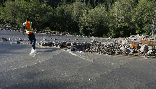 Francisco Kjolseth     The Salt Lake Tribune Adan Carillo, a public involvement manager, overlooks the damage being cleaned up by crews on about a dozen sections of Little Cottonwood Canyon from Tanners Flat campground and below that were blown out by rock debris following the violent rainstorm that started in the early hours on Friday, July 5, 2013.