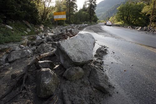 Francisco Kjolseth  |  The Salt Lake Tribune Crews clean up close to a dozen sections of Little Cottonwood Canyon from Tanners Flat campground and below that were blown out by rock debris following the violent rainstorm that started in the early hours on Friday, July 5, 2013.