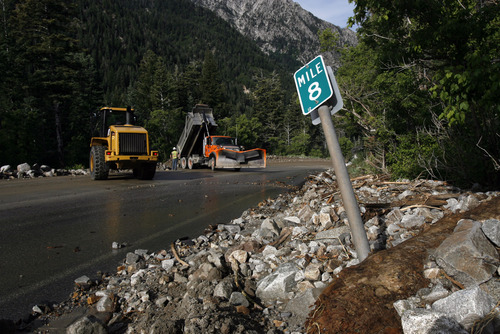 Francisco Kjolseth  |  The Salt Lake Tribune Crews clean up close to a dozen sections of Little Cottonwood Canyon from Tanners Flat campground and below that were blown out by rock debris following the violent rain storm that started in the early hours on Friday.