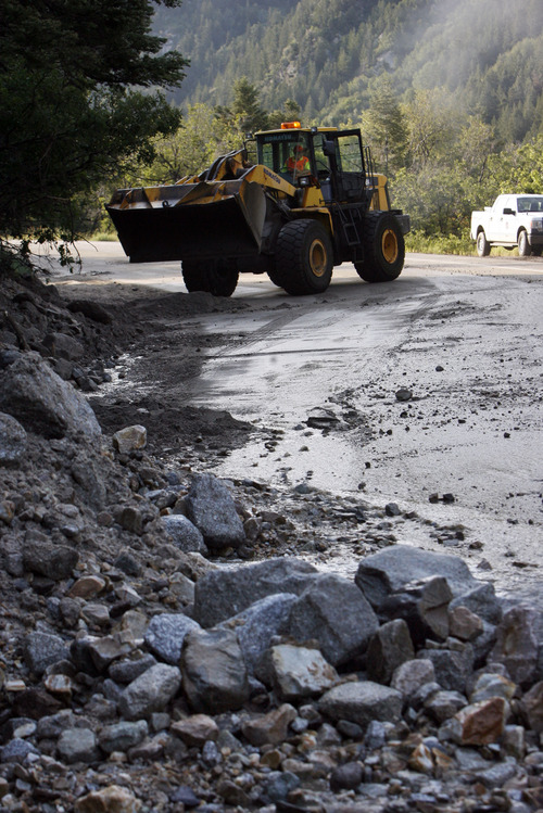 Francisco Kjolseth  |  The Salt Lake Tribune Crews clean up close to a dozen sections of Little Cottonwood Canyon from Tanners Flat campground and below that were blown out by rock debris following the violent rain storm that started in the early hours on Friday, July 5, 2013.