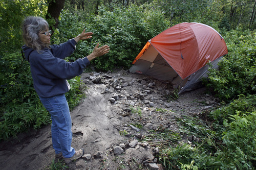 Francisco Kjolseth     The Salt Lake Tribune Camille Allred, of Lindon, describes her harrowing night alongside her husband, Clint, and son Kyle, 16, as their tent started to move in the middle of the night by the force of water and debris. The Allreds alerted authorities about the condition of the road after trying to leave the Tanners Flat campground up Little Cottonwood Canyon at 2:30 a.m. Friday due to the violent rainstorm on Friday.