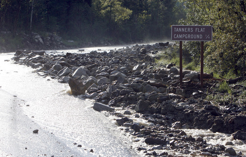 Francisco Kjolseth     The Salt Lake Tribune Crews clean up close to a dozen sections of Little Cottonwood Canyon from Tanners Flat campground and below that were blown out by rock debris following the violent rain storm that started in the early hours on Friday, July 5, 2013.