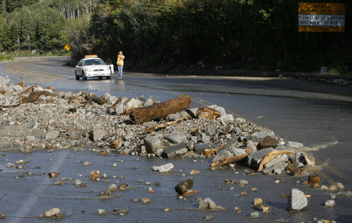 Francisco Kjolseth     The Salt Lake Tribune Crews clean up close to a dozen sections of Little Cottonwood Canyon from Tanners Flat campground and below that were blown out by rock debris following the violent rain storm that started in the early hours on Friday.