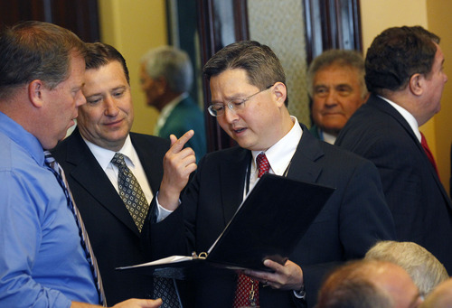 Al Hartmann  |  The Salt Lake Tribune Rep. Eric Hutchings, R-Kearns, left, meets with legislative counsel Brian Howe, and Rep. Dean Sanpei, R-Provo, to talk over HR 9001 before a House Republicans caucus meeting Wednesday, July 3.  HR9001 would create a special committee to explore allegations of misconduct against Attorney General John Swallow.