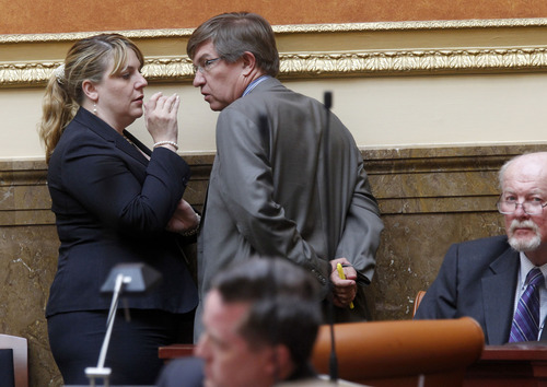 Al Hartmann  |  The Salt Lake Tribune Rep. Jennifer Seelig, D-Salt Lake City, House minority leader,  confers with Rep. Joel Briscoe, D-Salt Lake City, on the floor of the Utah House on Wednesday, July 3, during debate of HR 9001, which would create a special committe to explore allegations of misconduct against Attorney General John Swallow.