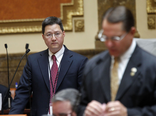 Al Hartmann  |  The Salt Lake Tribune Rep. Dean Sanpei, R-Provo, left, listens to Rep. Ken Ivory, R-West Jordan, speak to amend a part of HR 9001, which would create a special committee to explore allegations of misconduct against Attorney General John Swallow.