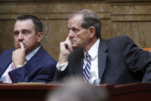 Al Hartmann  |  The Salt Lake Tribune House Majority Whip Greg Hughes, left, and Majority Leader Brad Dee listen to discussion of HR 9001, which would create a special committee to explore allegations of misconduct against Attorney General John Swallow.