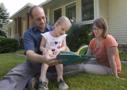 Paul Fraughton  |   Salt Lake Tribune Chad Downs and Jennifer Bodine read a story to their daughter, 5-year-old Kate Downs. She will be start school in August at the state's first charter academy run by a higher education institution, Weber State University.                              Thursday, June 13, 2013  Paul Fraughton  |   Salt Lake Tribune